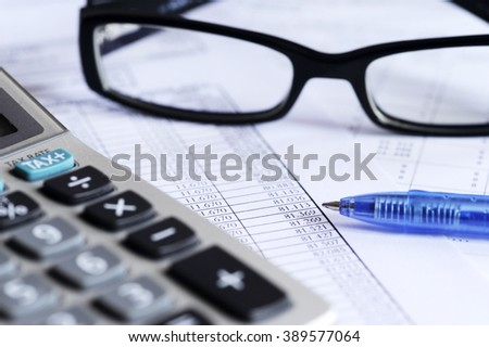 checking accounts with a calculator - stock photo