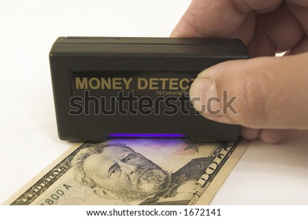 Checking banknote - stock photo