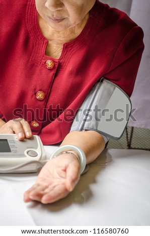 Checking blood pressure - stock photo