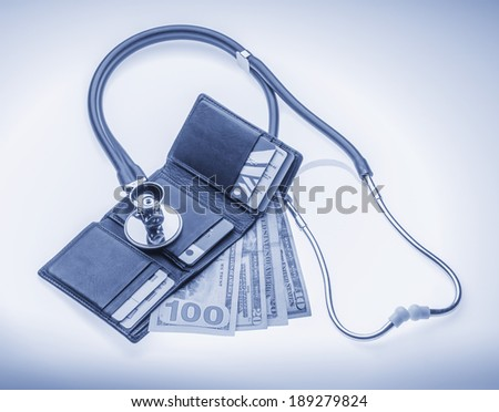 Checking cost of health care or the economy - stock photo