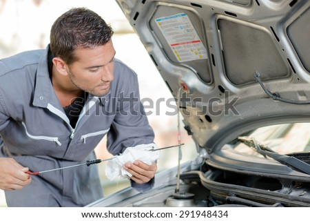 Checking engine's oil level - stock photo