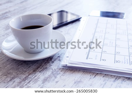 Checking monthly activities and appointments at the office