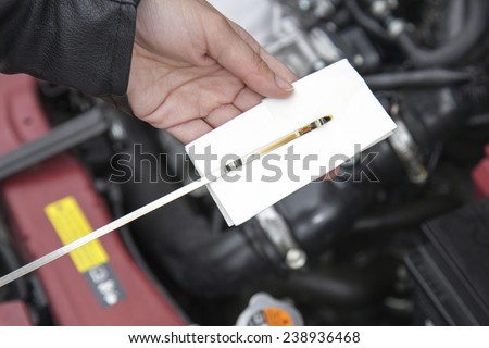 Checking motor oil level - stock photo