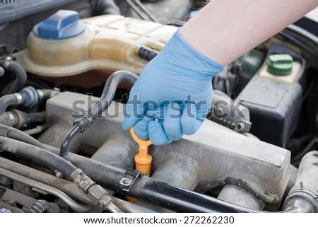 Checking oil - stock photo