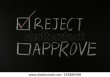 checking reject with chalk on blackboard - stock photo