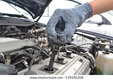 checking spark plugs in the car - stock photo