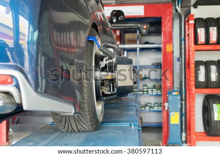 Checking suspension in a car by tool electronic tools at  car garage
