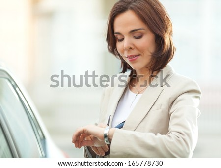 Checking that she's on time - stock photo