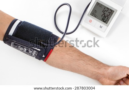 Checking the blood pressure with a modern digital equipment