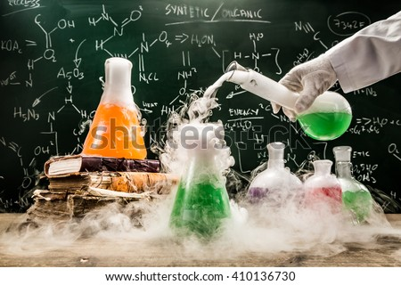 Checking the chemical formula in academic laboratory - stock photo