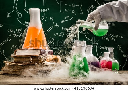 Checking the chemical formula in school laboratory - stock photo