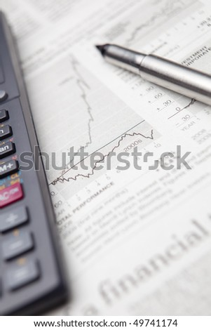 checking the situation on the financial markets in a newspaper - stock photo