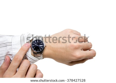 Checking time on wristwatch on white background - stock photo