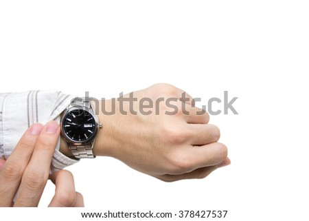 Checking time on wristwatch on white background