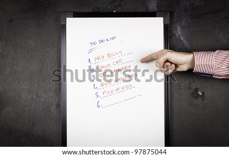 Checking to do list. - stock photo