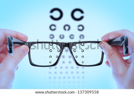 Checking vision on the table Golovin. In the blue shadows. - stock photo