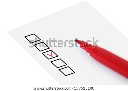 Checklist and red pencil closeup - stock photo