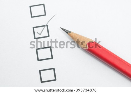 checklist box and red pencil. - stock photo
