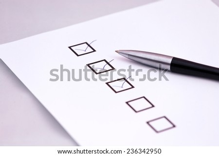 Checklist with a pen. - stock photo