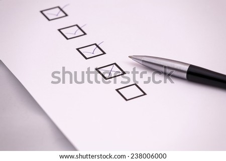 Checklist with a pen. - stock photo