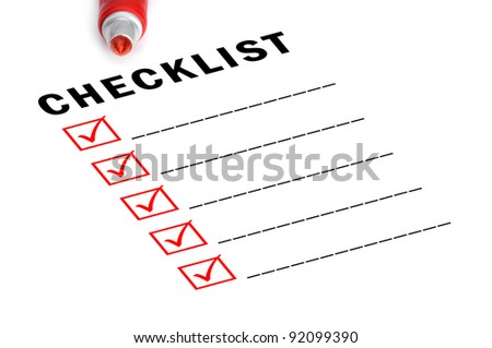 Checklist with red felt marker and checked boxes.