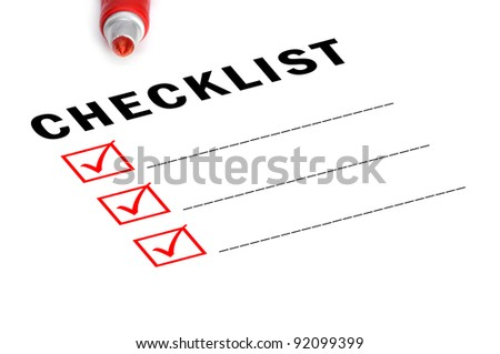 Checklist with red felt marker and checked boxes. - stock photo