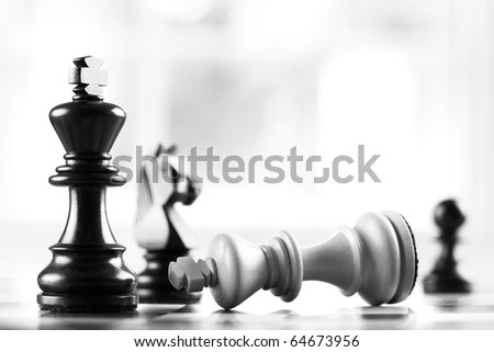 checkmate black defeats white king selective focus - stock photo
