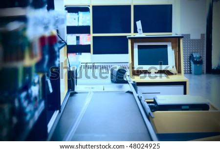 Checkout terminal in a supermarket, blue toned - stock photo