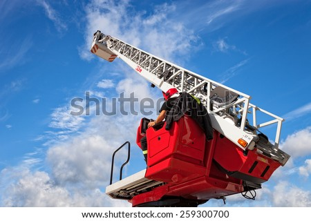 Checks and maintains the ladders on the fire truck. - stock photo