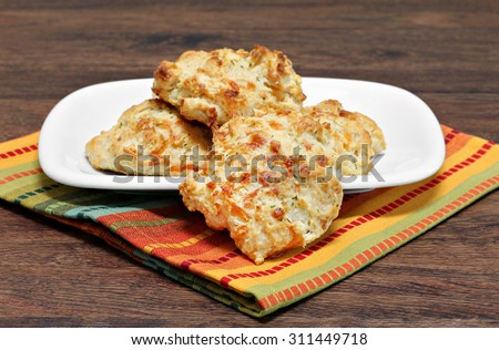 Cheddar cheese, garlic and parsley biscuits.  Selective focus on front biscuit.