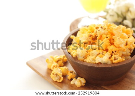 Cheddar cheese pop corn and soda drink - stock photo