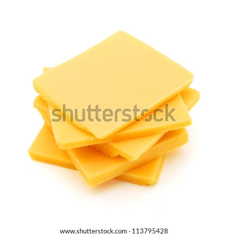 Cheddar cheese slices on white background. - stock photo