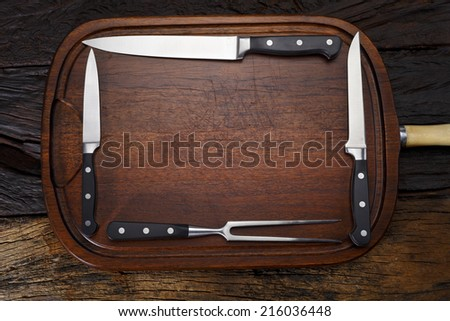 Cheef and BBQ knives on wood - stock photo
