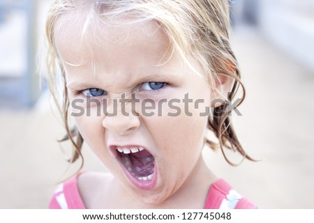 Cheeky girl doing a silly face - stock photo
