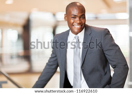 cheerful african american business executive in office - stock photo