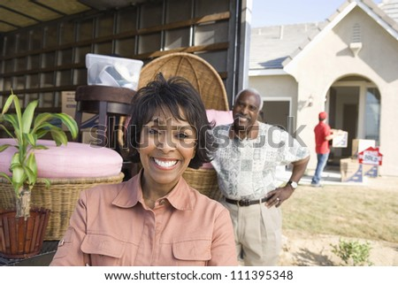 Cheerful African American couple moving to their new house - stock photo