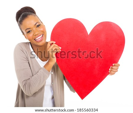 cheerful african american girl with heart shape against white background - stock photo