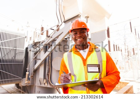 cheerful african electricity company substation worker - stock photo