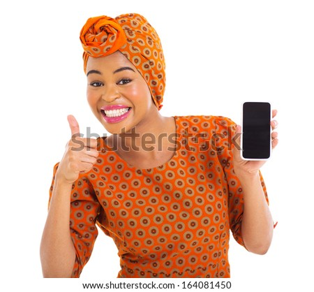 cheerful african girl holding cell phone and giving thumb up - stock photo