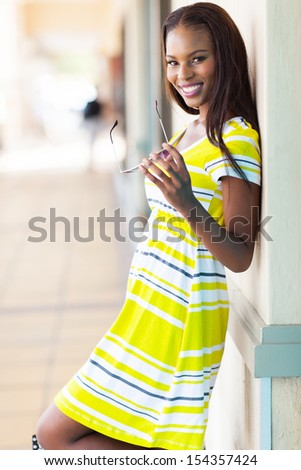 cheerful african woman in shopping center - stock photo
