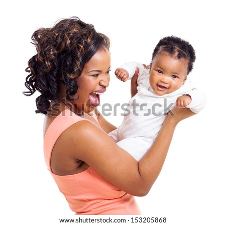 cheerful african woman playing with her little baby daughter on white background - stock photo