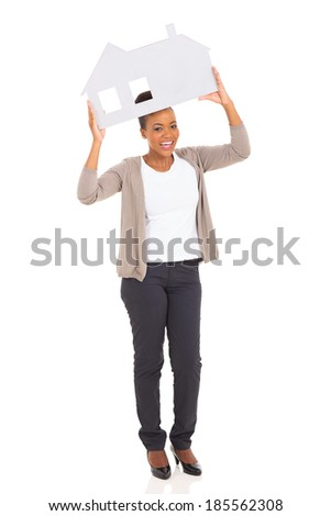 cheerful african woman showing house symbol on white background - stock photo
