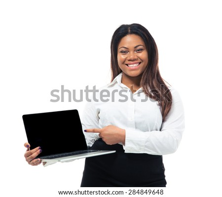 Cheerful afro american businesswoman pointing finger on blank laptop screen isolated on a white background. Looking at camera - stock photo
