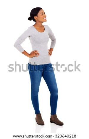 cheerful afro american woman looking up on white background - stock photo