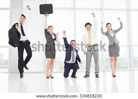 Cheerful and excited businesspeople with different expressions - stock photo