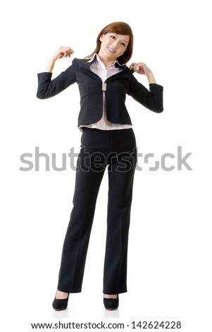 Cheerful and relaxing Asian business woman, full length portrait isolated on white background.