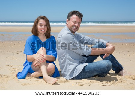 Cheerful and smiling Couple Enjoying Beach on Holiday