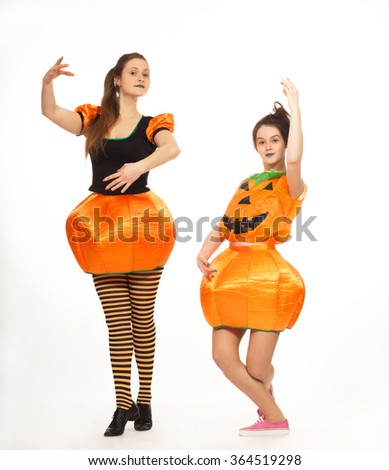 Cheerful animators in costumes for Halloween - stock photo