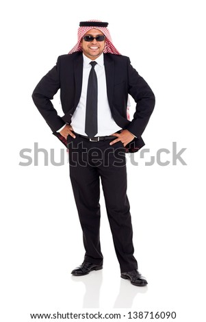 cheerful arab man in black suit posing on white background - stock photo