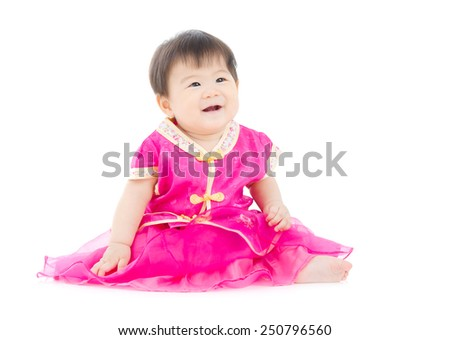 Cheerful asian baby in traditional cheongsam dress - stock photo